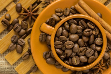 decaf: coffee beans in Cup on a wooden background