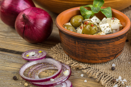 table top: Ingredients for cooking salad in ceramic ware on a wooden table Stock Photo