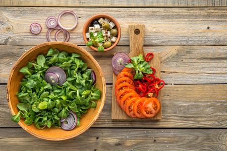 europe: Ingredients for cooking salad in ceramic ware on a wooden table Stock Photo