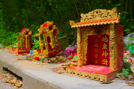 Chinese shrine is lined on the roadside. Stock Photo