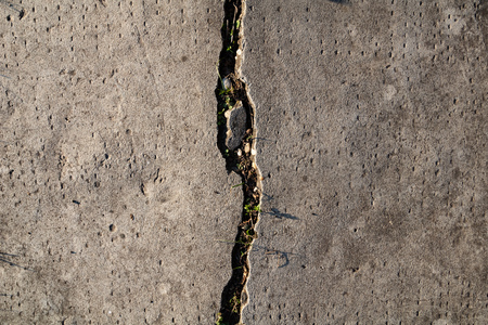 Grunge aged cracked concrete wall texture
