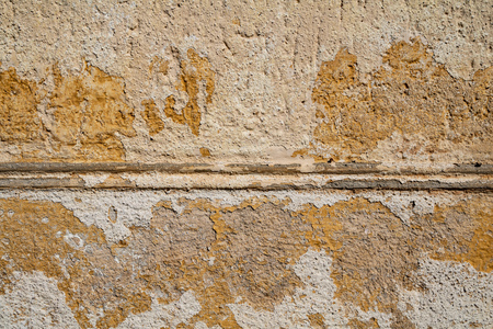 Yellow cracked weathered wall surface texture