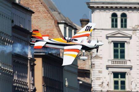 BUDAPEST / HUNGARY - JULY 4, 2015: Juan Velarde with N22ZE Zivko Edge 540 flying over Danube river in Budapest downtown at Red Bull Air Race 2015