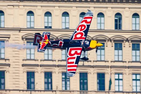 BUDAPEST / HUNGARY - JULY 4, 2015: Peter Besenyei with N806PB Zivko Edge 540 flying over Danube river in Budapest downtown at Red Bull Air Race 2015 新闻类图片