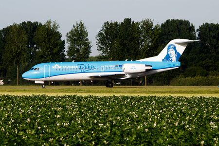 AMSTERDAM / NETHERLANDS - JULY 3, 2017: KLM Royal Dutch Airlines special livery Fokker 70 PH-KZU passenger plane taxiing at Amsterdam Schipol Airport Redactioneel
