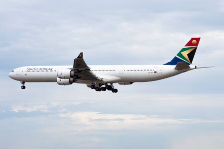 FRANKFURT / GERMANY - AUGUST 18, 2013: South African Airways Airbus A340-600 ZS-SNA passenger plane landing at Frankfurt Airport