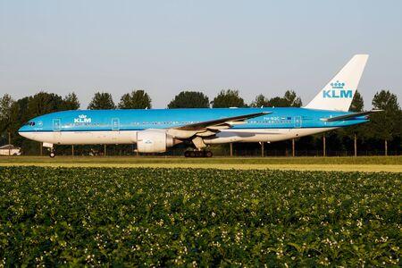 AMSTERDAM / NETHERLANDS - JULY 3, 2017: KLM Royal Dutch Airlines Boeing 777-200 PH-BQC passenger plane taxiing at Amsterdam Schipol Airport Redactioneel