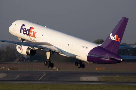 Vienna / Austria - April 18, 2019: FedEx Boeing 757-200 N972FD cargo plane departure and take off at Vienna International Airport