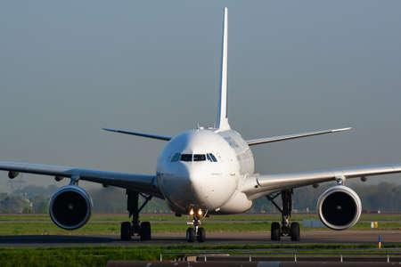 Paris / France - April 24, 2015: Air France Airbus A330-200 F-GZCK passenger plane arrival and landing at Paris Charles de Gaulle Airport Redakční