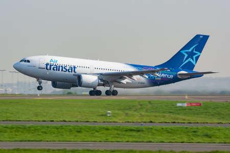 Paris / France - April 24, 2015: Air Transat Airbus A310 C-GFAT passenger plane departure and take off at Paris Charles de Gaulle Airport