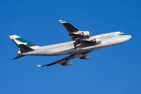 Hong Kong / China - December 1, 2013: Cathay Pacific Airways Boeing 747-400 B-HKE passenger plane departure and take off at Hong Kong Chek Lap Kok Airport