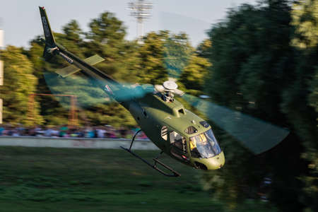 Szolnok / Hungary - August 20, 2019: Hungarian Air Force Airbus Helicopters Eurocopter AS350 H125M Ecureuil 102 military helicopter flying over Szolnok city downtown