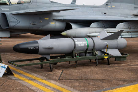 FAIRFORD / UNITED KINGDOM - JULY 13, 2018: Swedish Air Force SAAB JAS 39C Gripen 39293 fighter jet and RBS-15 missile static display at RIAT Royal International Air Tattoo 2018 airshow 新闻类图片