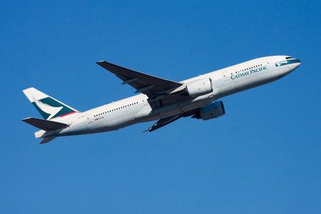 Cathay Pacific Airways Boeing 777-200 B-HNB passenger plane departure and take off at Hong Kong Chek Lap Kok Airport