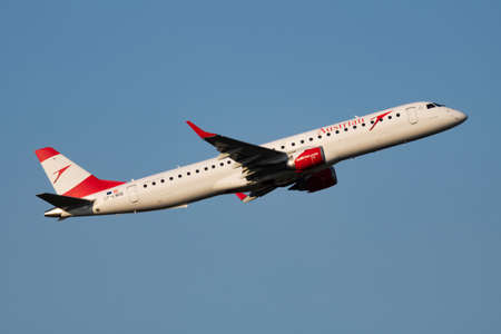 Austrian Airlines Embraer ERJ-195 OE-LWC passenger plane departure and take off at Vienna Airport