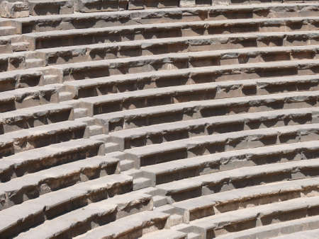 basra: Close up of rows of seats and stairway, auditorium, ancient Roman amphitheatre, Bosra, Syria