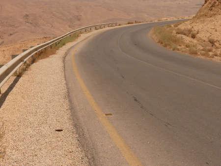 Roadside, asphalt road, curve, stone desert highway, Kings highway, Jordan, Middle East photo