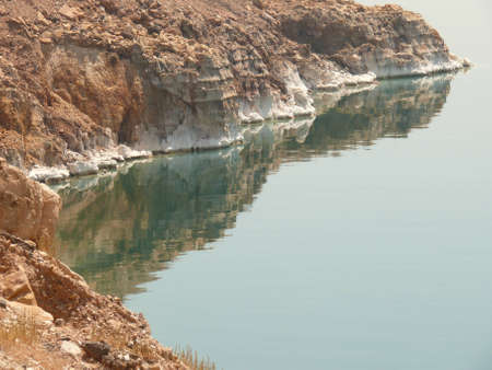Seashore, coast line of the Dead Sea, showing sediment of salt photo