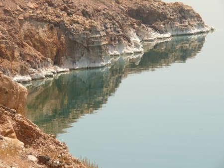 Seashore, coast line of the Dead Sea, showing sediment of salt photo