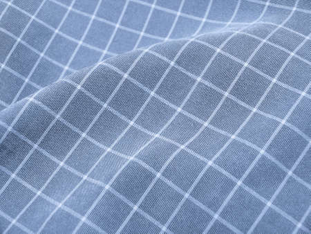 pleated: Pleated checkered blue fabric closeup. Ideal for background. Stock Photo