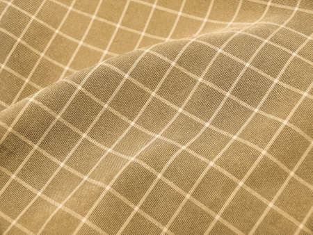 Pleated checkered brown fabric closeup. Good for background. photo