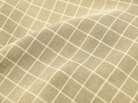 Pleated checkered ivory fabric closeup. Good for background. photo