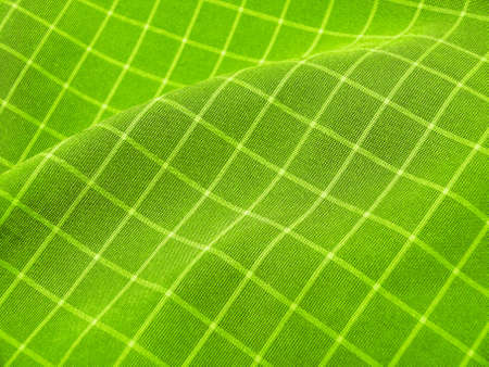 pleated: Pleated checkered vivid green fabric close up. Ideal for background. Stock Photo