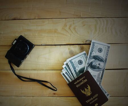 Travelers prepare before traveling abroad. Prepare passports, banknotes and compact cameras.Dark edges.