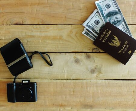 Travelers prepare before traveling abroad. Prepare passports, banknotes, compact cameras. Stok Fotoğraf