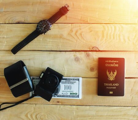 Travelers prepare before traveling abroad. Prepare passports, banknotes, wrist watches and compact cameras.sunset.