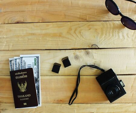 Travelers prepare before traveling abroad. Prepare passports, banknotes, wrist watches, compact cameras,and the memory cards. Stok Fotoğraf