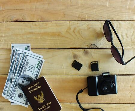 Travelers prepare before traveling abroad. Prepare passports, banknotes, wrist watches, compact cameras,and two memory cards.