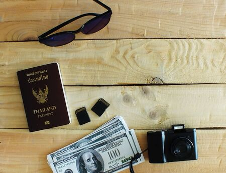 Travelers prepare before traveling abroad. Prepare passports, banknotes, wrist watches, compact cameras,two memory cards.