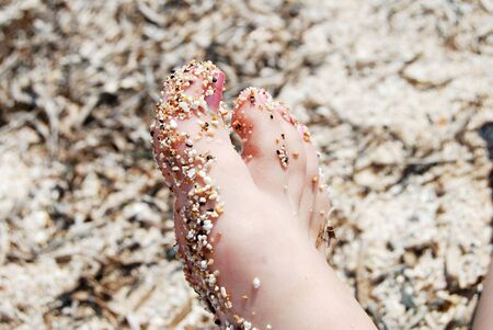 Close up of a beautiful foot with sands and rock on it, at the beach at Martigues, Marseille in France Stock Photo