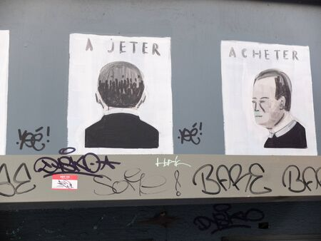 Charleroi, Belgium - December 28 2019: Street art: Buy - Ah, I have you - Throw away - Buy. A beautiful message against consumerism