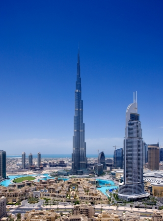 A skyline view of Downtown Dubai, showing the Burj Khalifa and Dubai Fountain