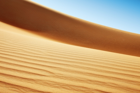 A view of the rolling sand dunes of the Arabian desert photo