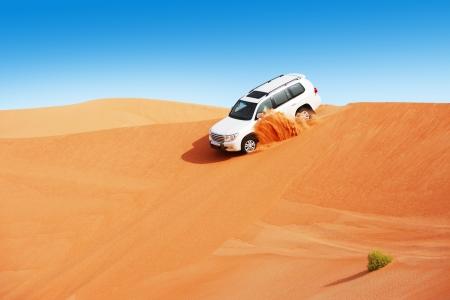 desert sun: 4 by 4 dune bashing is a popular sport of the Arabian desert Stock Photo
