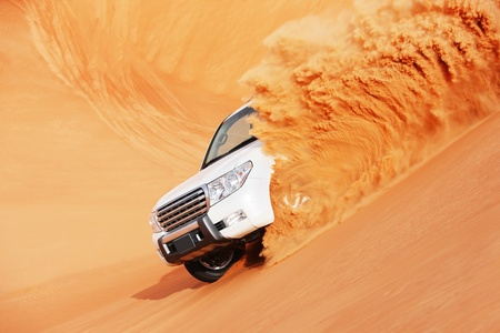 4 by 4 dune bashing is a popular sport of the Arabian desert Stock Photo - 16164209