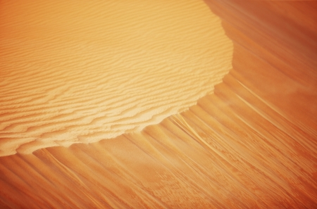 A view of the rolling sand dunes of the Arabian desert Stock Photo