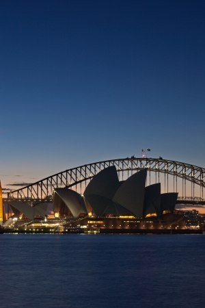 sydney harbour bridge: A Skyline View of Sydney at sunset showing Harbour Bridge and Sydney Opera House