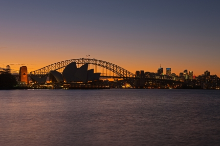 sydney harbour: A Skyline View of Sydney at sunset showing Harbour Bridge and Sydney Opera House