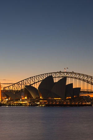A Skyline View of Sydney at sunset showing Harbour Bridge and Sydney Opera House