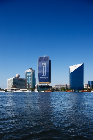 hotels building: Skyline view of Dubai Creek Skyscrapers and boats, UAE