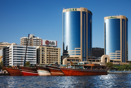 arabic architecture: Skyline view of Dubai Creek Skyscrapers and boats, UAE