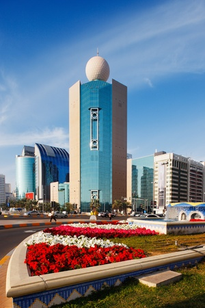 Architecture, bright flowers, and sunshine combine to make a colourful picture of Abu Dhabi