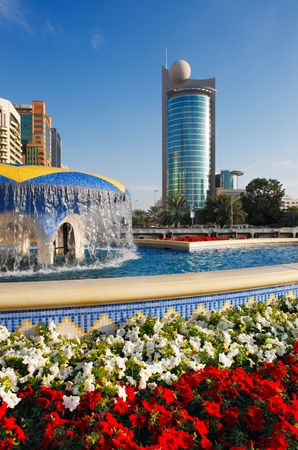 Architecture, bright flowers, water and sunshine combine to make a perfect picture of Abu Dhabi