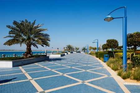 The Corniche promenade of Abu Dhabi is usually quiet during the hot mid summers days Editorial