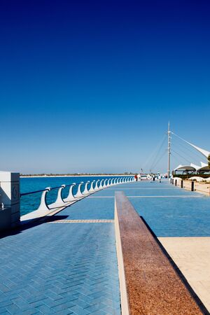 The Abu Dhabi Corniche is flanked by a beautiful promenade Stock Photo