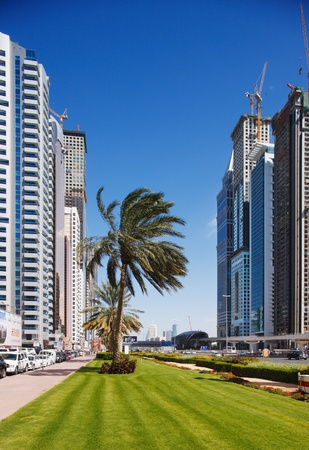 sheik: The tall towers of Sheik Zayed Road showcase much of Dubai s modern architectural developments� the grass is rather unusual